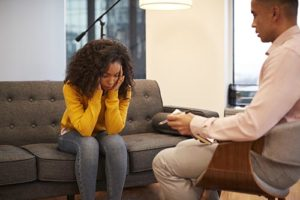 a woman beginning alcohol addiction treatment