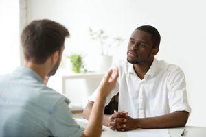 a man talking to his doctor about intensive outpatient treatment