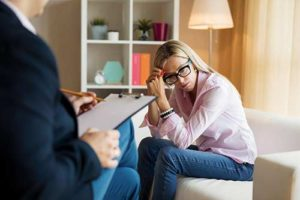 woman talking with therapist in trauma therapy